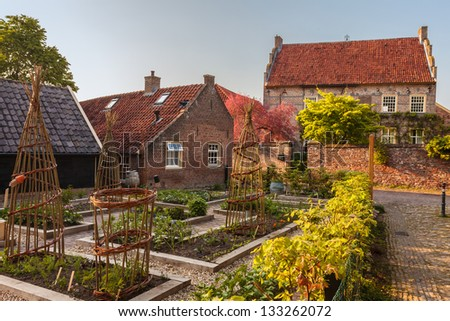 View at a vegetable garden in the medieval Dutch town Bronkhorst in Gelderland - stock photo