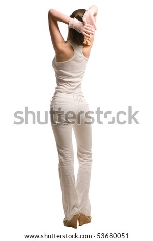 View at beautiful model woman from back view dressed in white pants and undershirt - stock photo