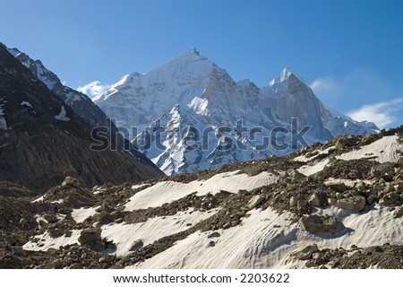 View at Bhagirathi Parbat, India and Gomukh glacier. Bhagirathi Parbat is a chine with peaks of 6510, 6450 and 6860m high. Gangotri glacier is 30 km long, here Ganga begins from. - stock photo