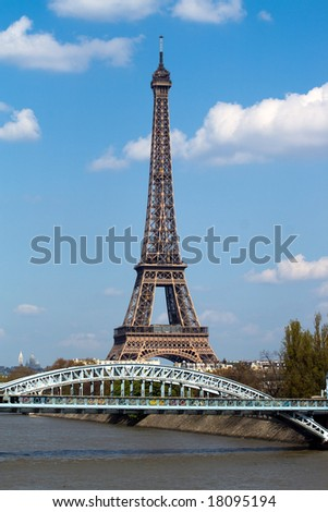 View at Eifel tower and railway bridge (Pont Rouelle) crossing island (Ile des Cygnes) in Paris
