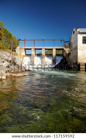View at hydroelectric power plant on Altai river Chemal - stock photo