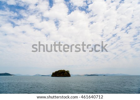 view at perfect tropical island, surrounding turquoise lagoon and blue sky