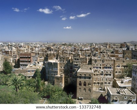 View at Sana'a the capital of Yemen.At the foreground palms and a small garden.