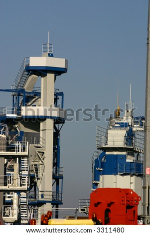 View at some batching plants utilities on a blue sky