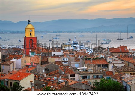 View at St.Tropez and anchored ships at sunset in French Riviera - stock photo