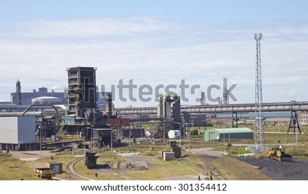 View at steel factory with blue sky - stock photo