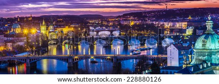 View at The Charles Bridge and Vltava river in Prague in dusk at sunset - stock photo