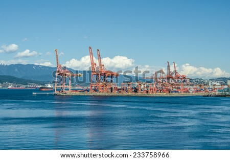 View at the container port terminal at nice sunny day. Vancouver, Canada. - stock photo