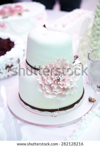 View at the white wedding cake