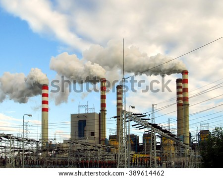 view chimneys, buildings and infrastructure, lignite-fired power plants, high smoking chimneys - stock photo