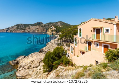 View coast sea apartment house sunny day, Camp de Mar, Majorca island, Spain - stock photo