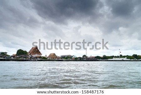 View dark cloud of temple and boat side river  - stock photo