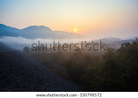 View fog and mountains at sunrise.