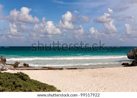 View from a Caribbean beach out over the turquoise ocean towards the horizon at Tulum, Quintana Roo, Mexico - stock photo