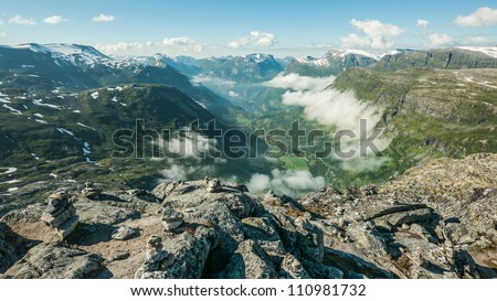 View from a mountain top on Geiranger and Geirangerfjord, Norway. Mount Dalsnibba. - stock photo