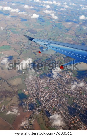 view from a plane on wing and on rural england (near heathrow airport, london) - stock photo