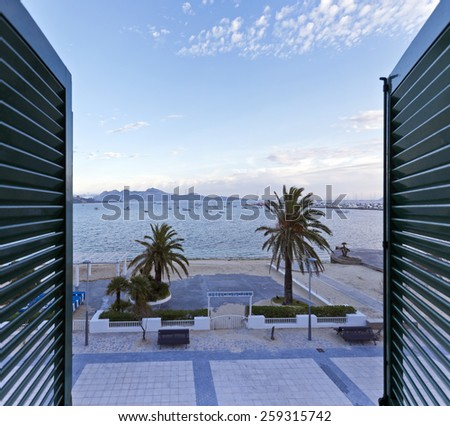 View from a window at the Port de Pollenca in northern Majorca - Spain. Majorca is the largest island in the Balearic Islands archipelago, in Spain. - stock photo