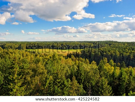 view from above at the valley between forests - stock photo
