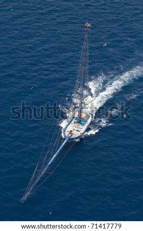 View from above of a boat in the messina strait - stock photo