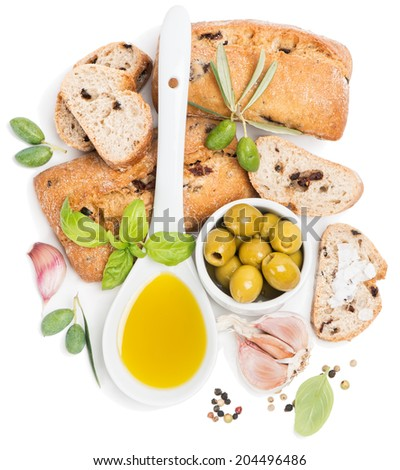 View from above of a olives, oil, slices of bread are on a white background  - stock photo