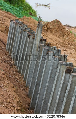 View from above of big concrete columns pin down the coast to prevent water erosion. - stock photo