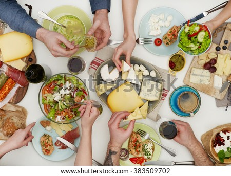 View from above of friends having dinner - stock photo