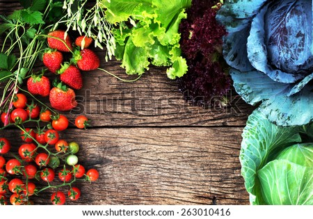 View from above of mix  vegetable and fruit on wooden background with space for text, clean eating food - stock photo