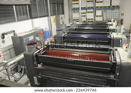 view from above of offset printing machine - stock photo