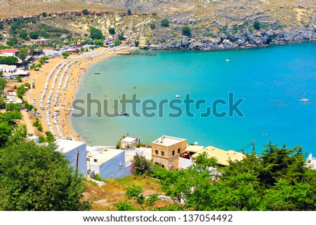 View from above of the main beach in Lindos - stock photo