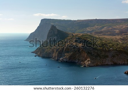 View from above on a rock washed by the sea - stock photo