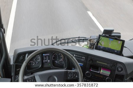 View from above on dashboard inside the cab of the truck while driving. The map is intentionally slightly out of focus. All potential trademarks are removed - stock photo