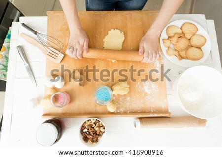 View from above on woman preparing dough for holiday cookies - stock photo