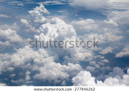 View from above the earth with the clouds below - stock photo