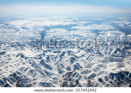 View from airplane at the snowy mountains, Turkey