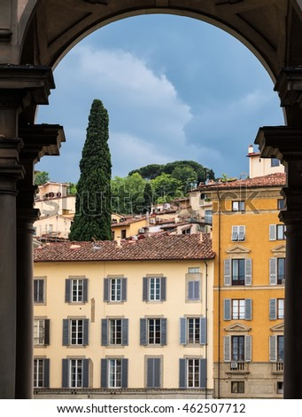 View from an archway, the colorful italian architecture in Florence, Italy.