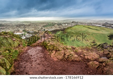 View from Arthur's Seat to Edinburgh in rainy day - stock photo