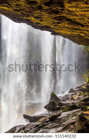 View from behind a tranquil waterfall of  Huai Luang Waterfall in Ubon Ratchathani, Thailand  - stock photo