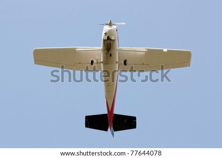 View from bellow of a small propeller plane flying - stock photo