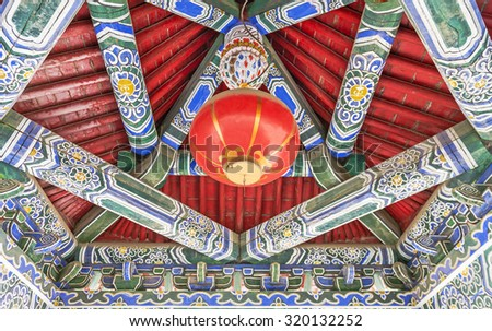 View from bellow on a red roof of buddhist temple - stock photo