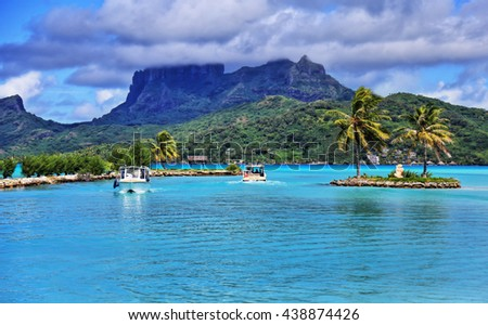 View from Bora Bora airport. Beautiful palms, mountains and blue sea. French Polynesia, South Pacific Ocean.  HDR (High dynamic range) picture. - stock photo