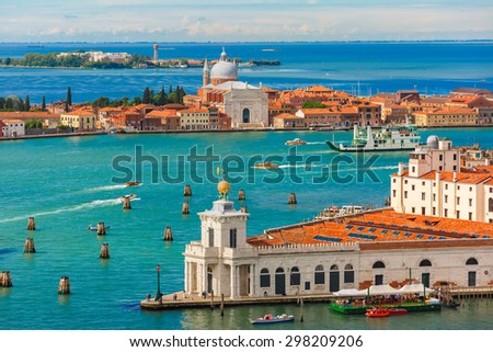 View from Campanile di San Marco to Dogana di Mare and Chiesa Santa Maria delle Zitelle and Vaporetto at summer morning on Giudecca island in Venice, Italy  - stock photo