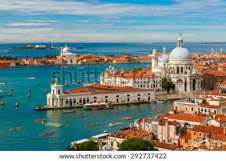 View from Campanile di San Marco to Grand Canal and Basilica di Santa Maria della Salute during Vogalonga regatta at summer morning in Venice, Italy - stock photo