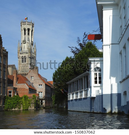 View from canal on Belfort tower (town hall) in Bruges, Belgium - stock photo