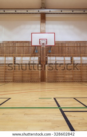 View from center court in old gym hall - stock photo