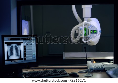 View from control desk of X-Ray system - stock photo