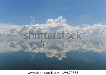 View from Cuba of clouds reflecting in the ocean - stock photo