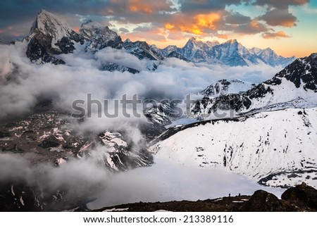 View from Gokyo Ri to Gokio, lake Dudh Pokhari, glacier Ngozumba, tops Cholatse and Tabuche - stock photo