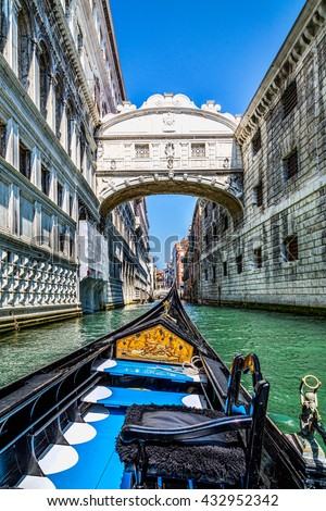 View from gondola during the ride under the famous arch Bridge of Sighs in Venice, Italy. Ponte dei Sospiri