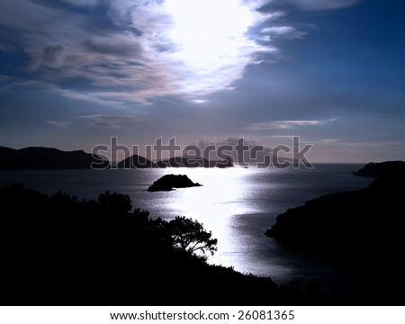 View from Great Barrier Island, New Zealand. (Little Barrier Island is in the distance covered in low cloud.) - stock photo