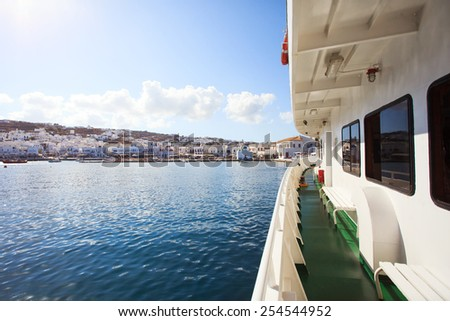 View from Greek ferry with view of Mykonos city.  - stock photo